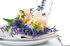 Table setting with freesias Royalty Free Stock Image