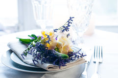Table setting with freesias Stock Images