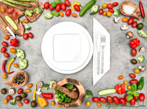 Table setting with fresh vegetables. Healthy food Stock Photography