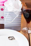 Table setting with a gift bags and rings Stock Photos