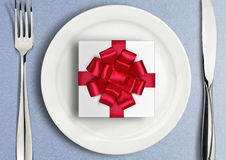 Table setting with gift box on plate. Top view Stock Photo
