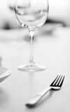 Table setting with glass. Table setting at a restaurant royalty free stock images