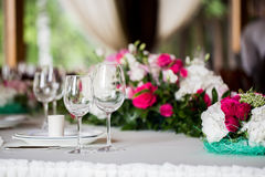 Table setting. Glasses on the table. Table setting. Glasses on the table, plates, utensils, tables. in the restaurant Royalty Free Stock Photography