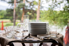 Table setting. Glasses on the table. Table setting. Glasses on the table, plates, utensils, tables. in the restaurant Stock Photos