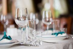 Table setting. Glasses on the table. Table setting. Glasses on the table, plates, utensils, tables. in the restaurant Stock Photo