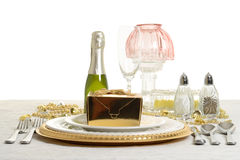 Table setting with gold gift Stock Image