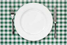 Table setting on green Gingham tablecoth Royalty Free Stock Images