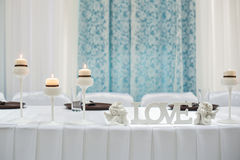 Table setting for a holiday with the letters LOVE.  stock photos