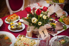 Table setting for a holiday, with red flowers Stock Photo