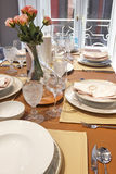 Table setting on a home dining room interior Royalty Free Stock Images