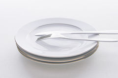 Table setting with knife and fork. And plates Stock Images