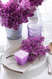 Table setting with lilac flowers Royalty Free Stock Photos