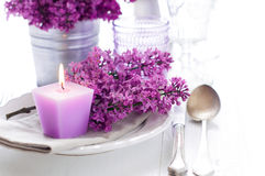 Table setting with lilac flowers Stock Images