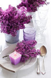 Table setting with lilac flowers royalty free stock photography