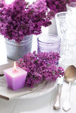 Table setting with lilac flowers Royalty Free Stock Images