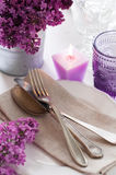 Table setting with lilac flowers Royalty Free Stock Photo