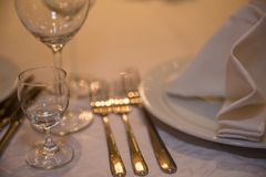 Table setting for a lovey dinner table setting table setting for a delicious dinner. At the restourant Stock Photo