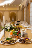 Table setting at a luxury wedding. In a luxury room Stock Photos