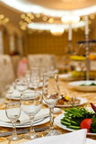 Table setting at a luxury wedding. In a luxury room Stock Photo