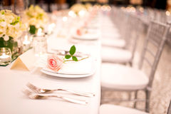 Table setting at a luxury wedding and Beautiful flowers. Stock Image