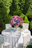 Table setting at a luxury wedding reception in the garden Royalty Free Stock Image