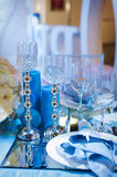 Table setting in maritime style with candles Stock Images