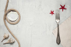 Table setting in maritime style with fork. In light colors Stock Images