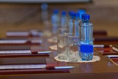 Table setting for meetings. mineral water, folder, pen. Table setting for meetings. mineral water, folder pen Royalty Free Stock Photos