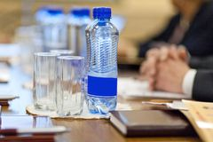 Table setting for meetings. mineral water, folder, pen. Table setting for meetings. mineral water, folder pen Stock Photo