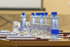 Table setting for meetings. mineral water, folder, pen. Table setting for meetings. mineral water, folder pen Royalty Free Stock Images