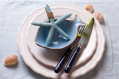 Table setting in nautical style Royalty Free Stock Photo