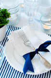 Table setting in navy blue tones Stock Photos