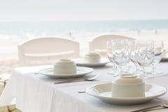 Table setting near beach restaurant. On background stock image