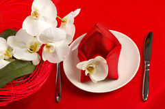 Table setting with orchid flowers Stock Photos