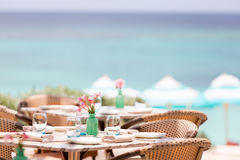 Table setting outdoor. Beautiful table setting in pastel tones in outdoor cafe at the beach or resort Stock Image