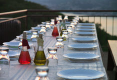 Table setting for outdoor party. Set table on the terrace in the evening Royalty Free Stock Image