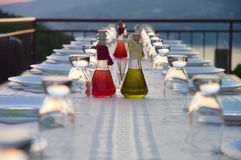 Table setting for outdoor party. Set table on the terrace in the evening Royalty Free Stock Photo