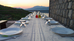 Table setting for outdoor party. Set table on the terrace in the evening Stock Image