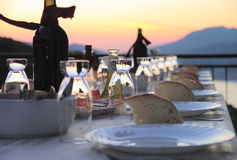 Table setting for outdoor party. Set table on the terrace in the evening Royalty Free Stock Images