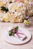 Table setting in pink color with flowers Stock Image