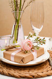 Table setting with pink flowers Stock Photography