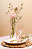 Table setting with pink flowers Stock Photo