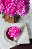 Table setting with pink peonies, vintage cutlery and brown table Stock Photos