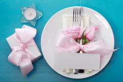 Table setting with pink roses Stock Photo
