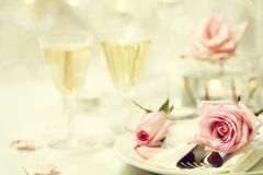 Table setting with pink roses Royalty Free Stock Images
