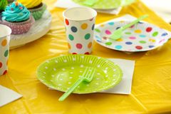Table setting with plastic ware. For summer picnic Royalty Free Stock Images