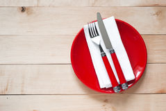 Table setting with a plate, cutlery and napkin Royalty Free Stock Photos