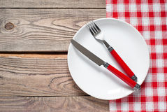 Table setting with a plate, cutlery and napkin Stock Photos