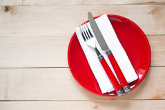 Table setting with a plate, cutlery and napkin Royalty Free Stock Image