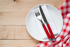 Table setting with a plate, cutlery and napkin Royalty Free Stock Images